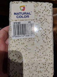 Natural color highly porous filter media